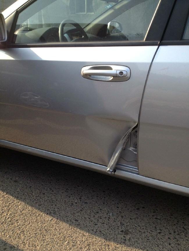 标致307两厢用车维修问答 -开车门被撞,维修大概得多少钱高清图片